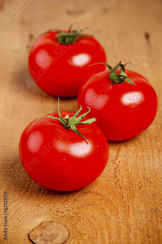 Tomatoes, cooked with herbs for the preservation on the old wood