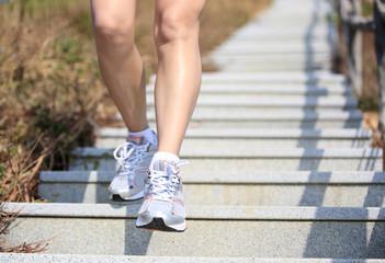legs running at mountain stone stairs
