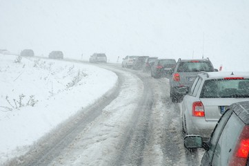 Traffic jam in heavy snowfall on mountain road