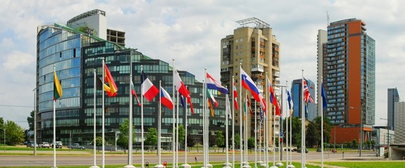 Vilnius city skyscrapers and European Union flags.