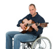 man in the wheelchair playing guitar