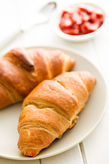 two croissants on wooden table