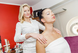 Massage procedure with two young woman