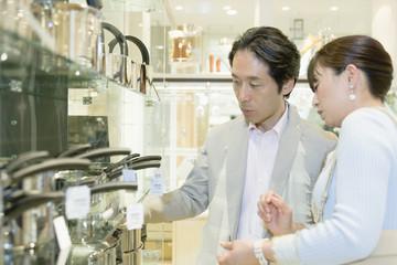 husband and wife choosing tableware