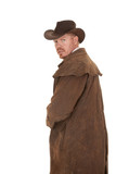 Cowboy leather duster look back afraid
