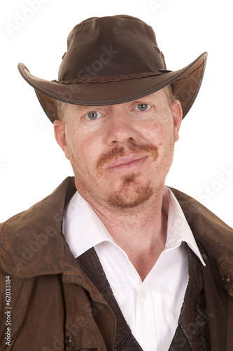 Cowboy leather coat hat smirk close