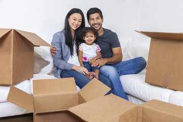 Asian Chinese Family Unpacking Boxes Moving House