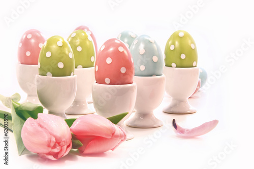Colorful easter eggs in white cups