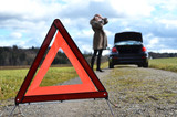 roken car, girl and warning triangle