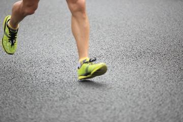 marathon athletes legs running on street