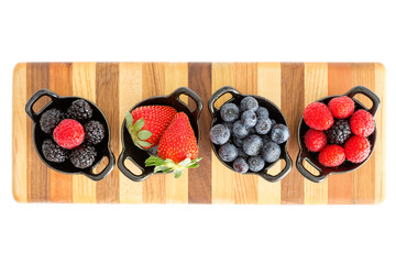 Ripe fresh autumn berries in separate dishes