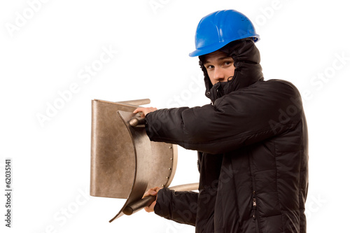 Violent hooligan brandishing a wooden chair