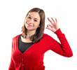 Woman making Ok sign over white background
