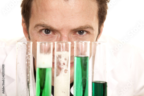 Mad scientist look over test tubes close