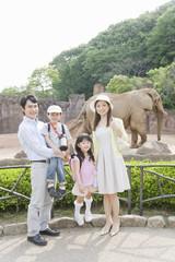 family visiting zoo