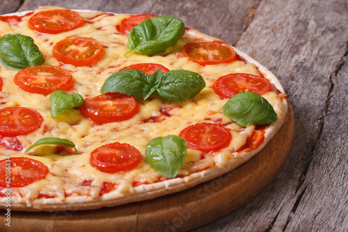 Margarita pizza with tomatoes, cheese and basil