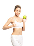 A sporty, fit and beautiful girl with an apple isolated on white