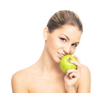 Portrait of a beautiful and sensual girl eating an apple