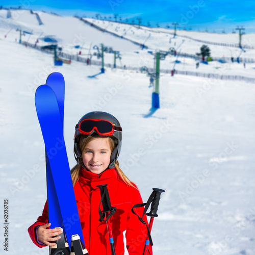 Kid girl winter snow with ski equipment