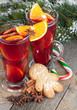 Christmas mulled wine with spices, gingerbread and snowy fir tre