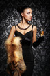 A beautiful woman with the glass of champagne - 62036930