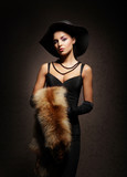 A beautiful woman in fur on a vintage background