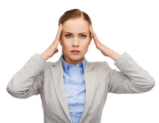stressed businesswoman having headache