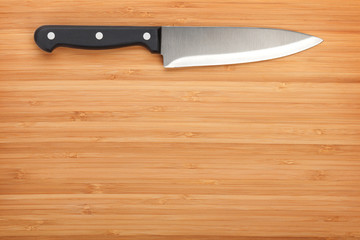 Kitchen knife on cutting board