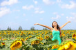 Happy carefree summer girl in sunflower field