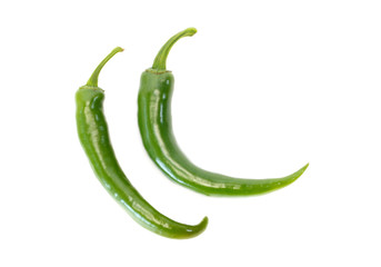 Two fresh green chile pepper