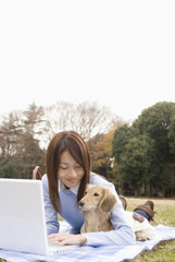 woman operating PC and dog