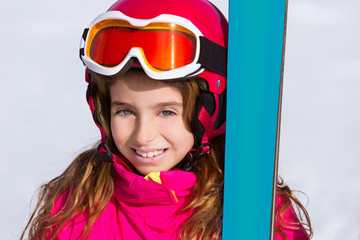 Kid girl winter snow portrait with ski equipment