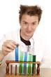 Mad scientist pick up blue test tube