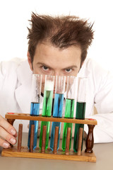 Mad scientist look over test tubes