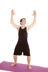 Man black tank top stand hands up