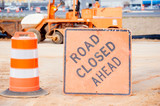 orange road closed sign at construction site