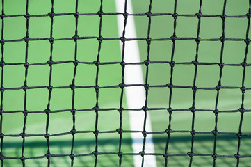 close up of tennis court net black and green