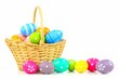 Easter basket filled with colorful eggs on a white background