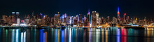 "Постер, картина, фотообои ""New York midtown panorama by night"""