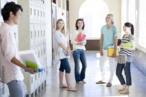 students standing still at hallway of school