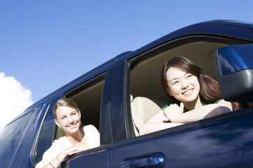 two women leaning out from car window