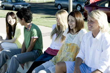 young people sitting in a line