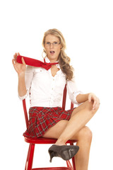 School girl sit red skirt pull tie