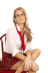 School girl sit red skirt lean forward
