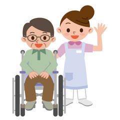 介護士と車椅子のシニア男性