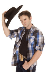 Cowboy with black hat in hand by head