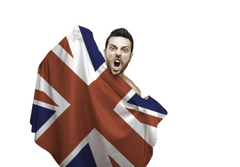 Fan holding the flag of UK celebrates on white background