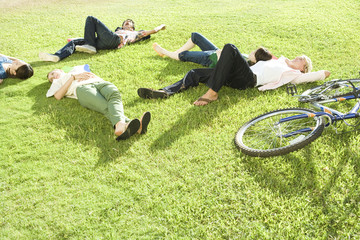 young men lying on lawn