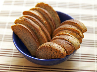 Wheat crackers with poppy seeds on a plate