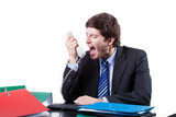 Businessman shouting to phone